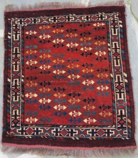 Rare and important fragmentary finely woven Yomud Okbosh with full pile and jewel-like copious silk highlights, circa 1800, 21'' X 19''(53 X 44cm)