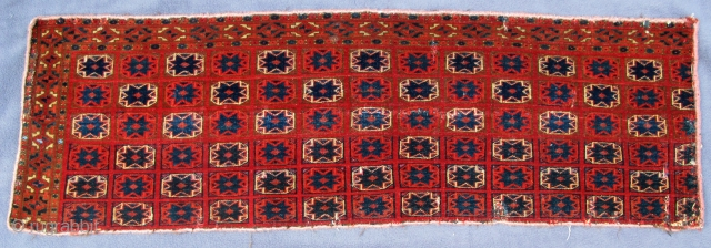 """Rare finely woven Saryk Jollar fragment of the 18th. century, pashmina wool, good pile, crimson and blue silk highlights, symmetric knotting, 40"""" X 13""""[101 X 33cm]NOTE there is a slight shadow reflected in the  ..."""