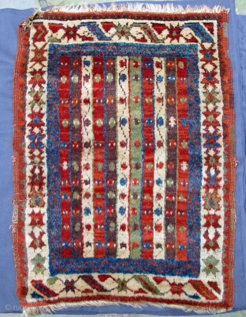 """Yürück Yastik woven with luminescent wool from high mountain sheep, thick shiny pile, incredible natural colors including an intense aubergine, remainder of a glue application on the back needful of further removal, 19th. century, 35"""" X  ..."""