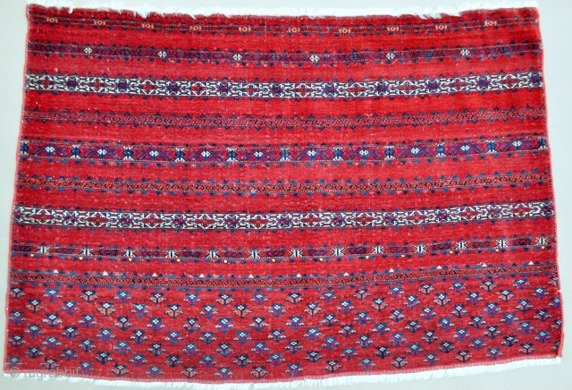 """Rare finely woven Tekke Chuval, circa 1800 with areas of corrosive red insect dyes, ruby red silk, corrosive white cotton, corrosive blue dye, 43"""" X 29""""[110 X 74cms]"""