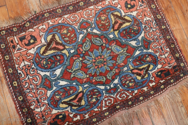Antique Small rug.  Not sure where its from..  Maybe afshar maybe shiraz?  Measure 2'11'' width 2'1'' length.  Has some low areas but hard to see from eye.