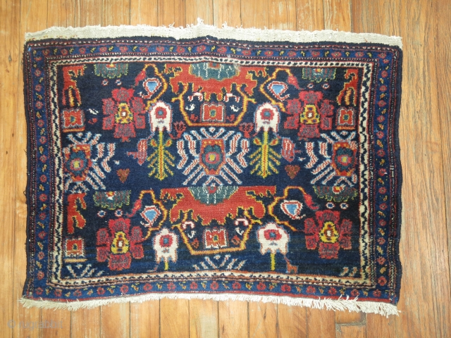Antique Persian Senneh 2'6''x1'9''.  I believe one end is slightly missing.  Or maybe thats the way the weaver wished to end the weave.