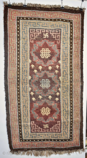 """Early 19thC Tibetan """"khaden""""(sitting rug;to go on a single bed) This larger knot type is attributed to Gamba Dzong (There are several spellings used in English;it is a trading town with a fort  ..."""