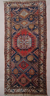 East Caucasus village rug. 1890 - 1915. 120 x 250 cm.
