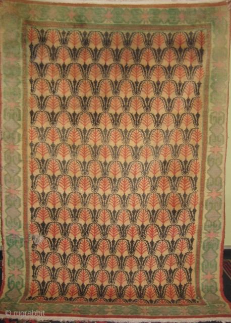 Old Tibetan carpet size 6 x 4ft minor repair.
