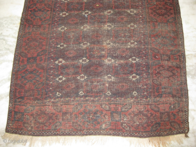 Baluch rug with wear throughout, measuring 6.9 x 3.4 ft