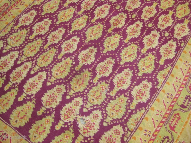 Very old Cotton Agra carpet with pink wefts and white warps, needs repair, measuring 7 by 5 feet approximately.