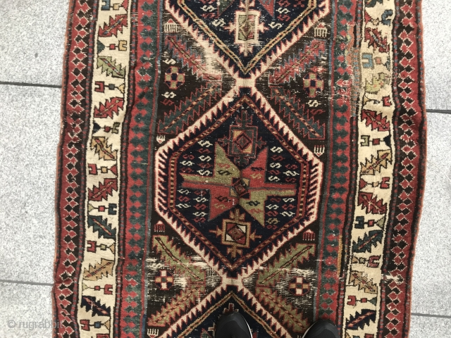 A northwest Persian or shahsavan long rug. As found.  Lots of interesting motifs.  Variable wefting.