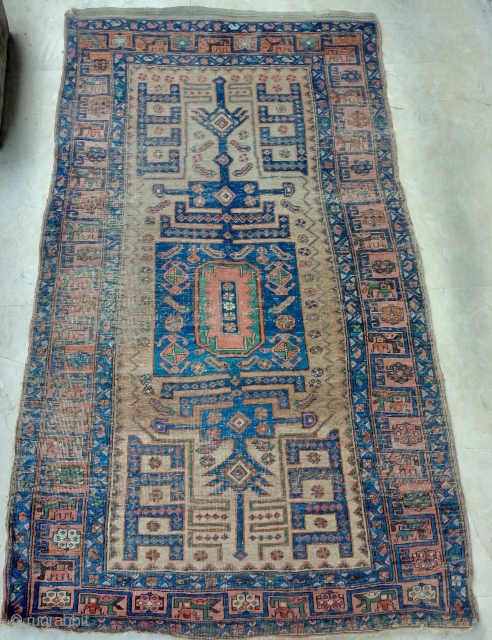 Approximately 4x7 Kurd Bijar type rug with Baluch sentiments.  Old money wear to go with it. Actual colors deeper than imaged.