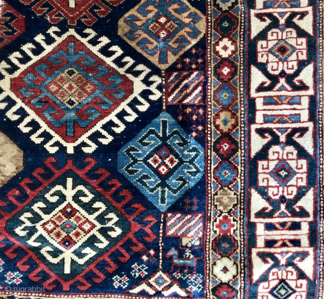 Old Kuba Rug Fragment with Kufic Border and Latch hook Medallions....