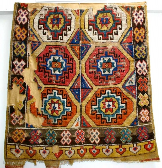 """Brilliant Konya Rug fragment.  This is the older version of these """"Memling Gol"""" yellow ground Konya Yataks. It has the large Memlings with equally dynamic center diamond motifs holding the design  ..."""