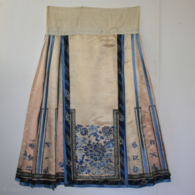 Qing Dynasty  CHINESE SILK SKIRT.  This soft pale pink colored antique Chinese silk skirt is from the late 1800's. The over all traditional embroidery mainly uses satin stitch technique. But the large  ...