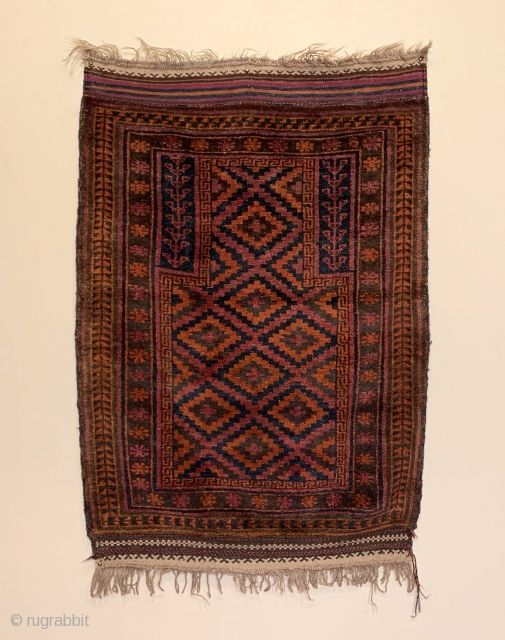 "Antique Taimani Prayer Rug. W. Afghanistan. 1st Quarter 20th Century. Purple lattice frame ascending stepped diamonds radiating upwards into mihrab (prayer arch). 4'6"" x 3'1"". 5 colors. Checkered 2 cord selvage. Lustrous  ..."