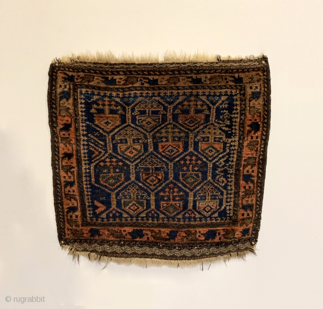 """Antique Timuri Baluch Bagface. 3rd Quarter 19th Century. Dokhtar-I Ghazi honey comb design. Saturated colors including a nice green. Very good condition. Original four sides and no repairs. 6 colors. 1'8"""" x  ..."""