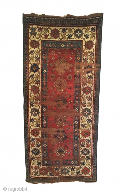 Early Caucasian Kazak Long Rug. 1st Half 19th Century. Great use of saturated coloration. Note the 'crab border,' appears to be four birds arrayed around cross palmettes via striped vines. Wear to  ...