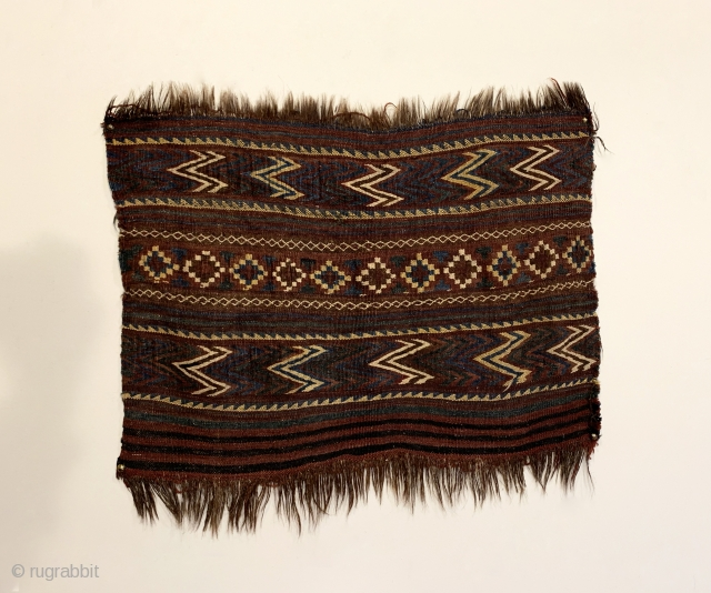 "Antique Uzbek Kilim Bagface. Rare size. Horsehair foundation. Rows of alternating colored chevrons and stepped diamonds. Truly tribal, original condition. 6 colors. 1'9"" x 2'3"". Professionally hand washed."