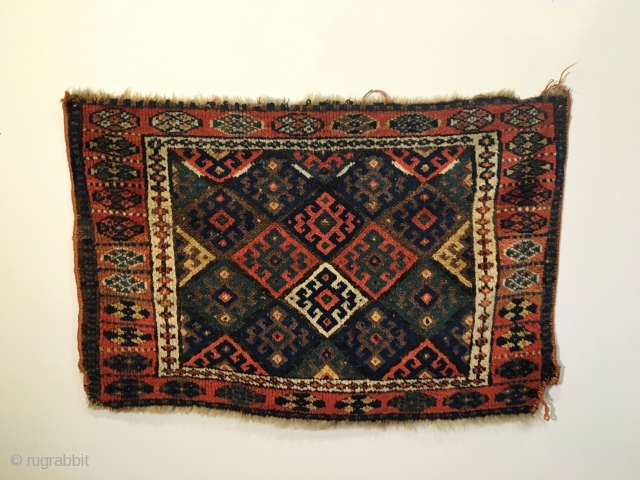 Jaf Kurd Bag face.  Circa Antique.  Four conjoined hooked motifs create center diamond surrounded by purple brown field.  Soft and thick pile.  Very good condition.  Old re-selvaged  ...