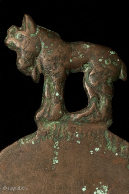 """Mirror with Ram Handle,  Central Asia, Bronze, 4th/3rd Century BCE, 3.75x5 in/9.5x13 cm.    This mirror is identical to a piece found in the Taklamakan, the """"Desert of No Return"""" in Western China. That object  ..."""