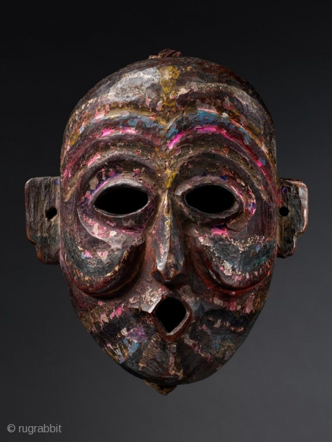 Kukpa,  Monpa or Sherdukpen, Arunachal Pradesh or Bhutan,  Wood, pigments,  19th Century; Provenance Roger Hollander Collection,  Published: Masks of Fabled Lands, 2009 plate 70,  8 in/20 cm,     This mask shares the same diamond mouth as the former  ...