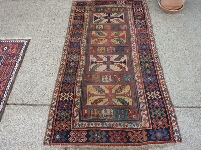 SOLD   THANK YOU!   Antique Caucasian pile rug in somewhat distressed condition.  Unusual pattern and a rich array of intriguing colors and designs,  Rings on back indicate  ...