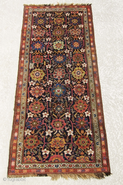 """Antique NW Persian rug, outstanding colors, all veg dyes, awesome design, ends and selvages are complete and original. size is 8'-7""""x3'-1""""."""