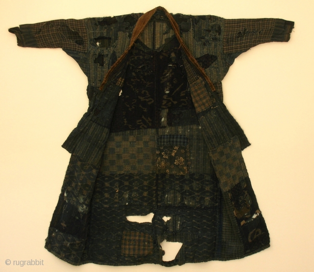 BORO noragi, Japan, late Meiji (circa 1900), cm 117x123. This is a very incredible noragi (work coat) made of recycled indigo dyed cottons; in other words it is a 'boro' jacket that  ...