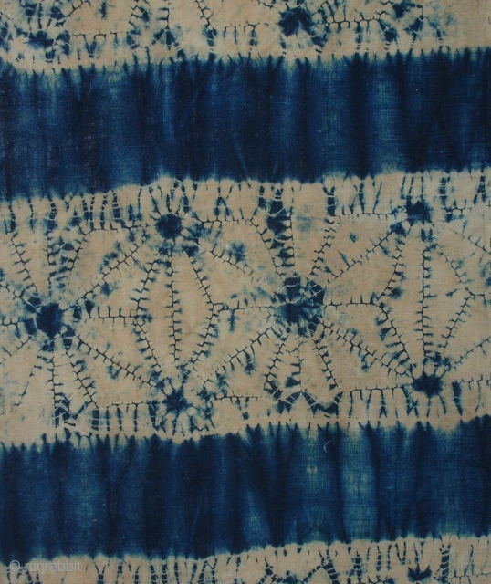 """Indigo Kumo shibori koshimaki , Japan, late Meiji (c.1900), 111x65cm. The common English translation of the Japanese word shibori is """"tie-dye""""; however, a more accurate translation is """"shaped-resist dyeing,"""" which describes the  ..."""