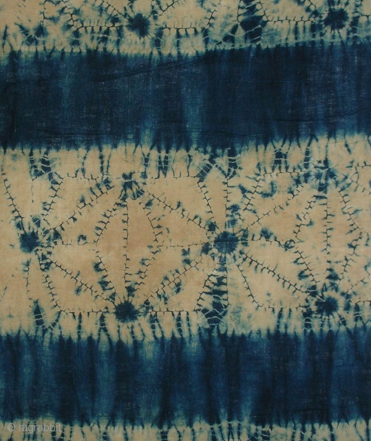 """Indigo Kumo Shibori Koshimaki , Japan, late Meiji (c.1900), 101x61cm. The common English translation of the Japanese word shibori is """"tie-dye""""; however, a more accurate translation is """"shaped-resist dyeing,"""" which describes the  ..."""