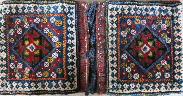 "Qashkai mini double bag with fine high altitude wool, thick pile and saturated colors. Has some patina and great condition. Circa 1900 or earlier Size: 24"" X 12"" - 61 cm X  ..."