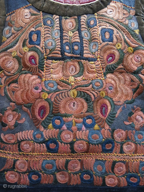 Hungarian woman's vest, silk embroidery on sheepskin, very bottom black part is hand braided. Lined with lamb's wool skin. They were made by master artisans from Carpathians. Fairly in good condition. Circa:  ...