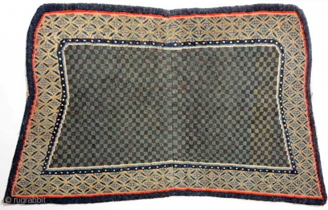 Tibetan under-saddle carpet (makden) of the so-called 'butterfly type', the shape of which is generally believed to have been 'introduced' by the Younghusband expedition to (i.e. the British invasion of) Tibet in  ...