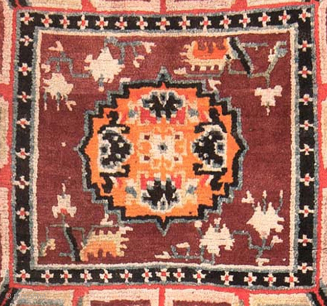 Two seating squares (sometimes referred to as 'mediation' squares / carpets) that have almost certainly come from a much longer Tibetan 'runner' (a very long narrow carpet) that would have consisted of  ...
