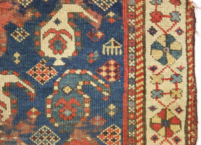 """Antique little caucasian rug with an unusual border, unfortunately, ravaged by wolves. Interesting older piece, probably kazak. All natural colors featuring an unusually nice yellow. """"as found"""". 3rd quarter 19th c. 2'8""""  ..."""