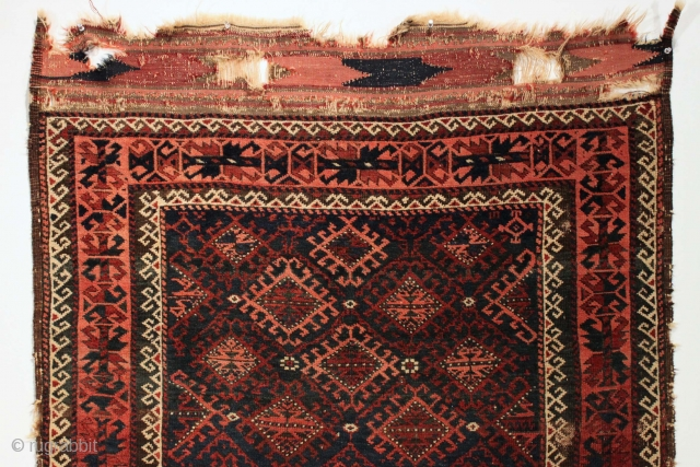 Antique baluch rug. Beautiful blue ground. High quality glossy wool. Unusual and complex lattice desgn. All natural colors. Mostly good pile, some low areas and spots of wear as shown. Clean. Nice  ...