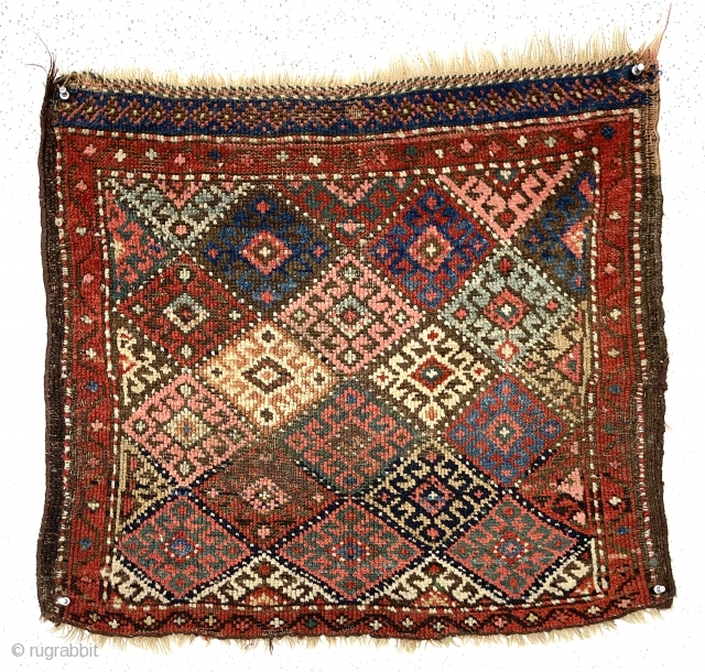 Antique jaf Kurd diamond bagface with an uncommon dotted lattice. Overall low pile with some wear exposing foundation. Original selvages. Good range of natural colors including multiple blues and reds. As found,  ...