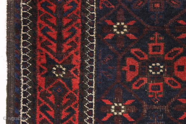 Old baluch rug with mina khani design field and an interesting border. Unusually small size for the type. All good colors featuring a strong ember red. Overall fair condition with mostly good  ...
