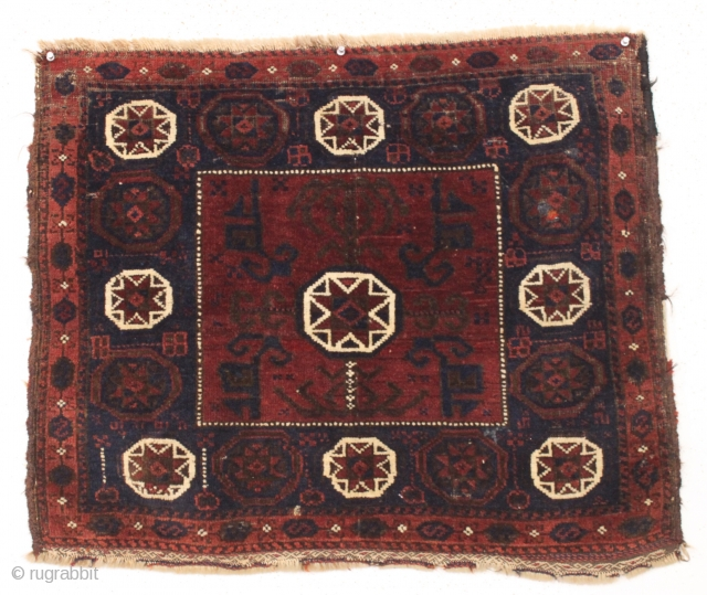 """old baluch square middle bagface. Dark and mysterious as a baluch can be. Mostly good thick pile. I see a few knots of old poor repiling. Priced accordingly. 19th c. 26"""" x  ..."""