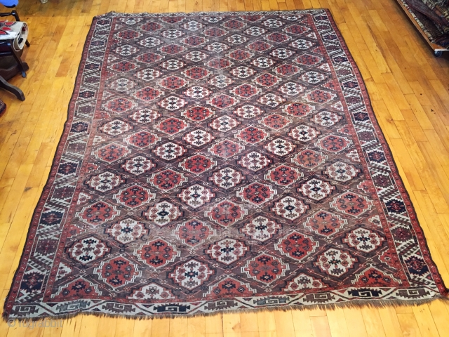 Old turkman chodor main carpet with classic ertman gul design. Overall fair condition for a genuine antique example. Scattered wear as shown but no holes or big damage. Structuraly sound and folds  ...
