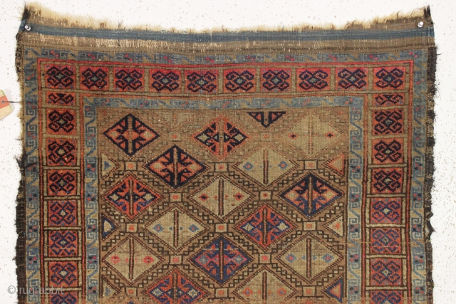 antique baluch rug. Interesting little rug with unusual and attractive coloring. Turkish knotted. As found, dirty with wear and edge roughness as shown. Old cleaning or storage tag included. Late 19th c.  ...