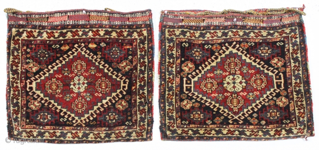 pair of antique south persian bags fresh from a local North Shore home. Both bags complete with original backs, closure tabs and loops. Both pieces in good pile with all natural colors.  ...