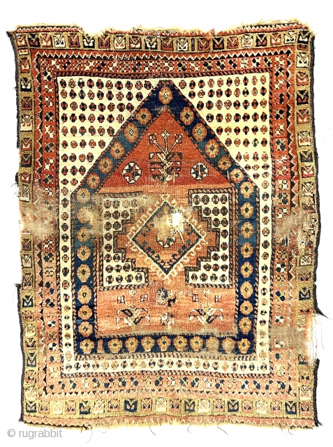 Antique little tribal prayer rug, probably monastir, with eye catching archaic drawing. Rough condition with an assortment of tears, holes, gouges and wear. Some decent pile. Characteristic monastir soft palette. Could use  ...