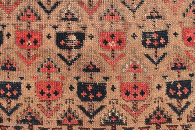 Antique small Baluch rug. Soft, supple and sophistacated. Older piece with very delicate drawing. All natural colors including a beautiful soft purple. Camel wool ground. Fair condition for the age with some  ...