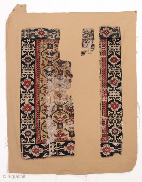 """Early Shirvan rug fragment. Great design, great colors. All natural colors featuring a fine old purple. Mounted on cloth as shown. Ca. 1850 or earlier weaving. largest piece 1' 6"""" x   ..."""