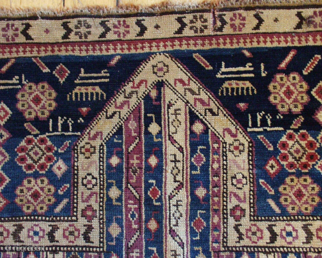 """Antique small caucasian prayer rug, probably Karrabaugh. Appears to be dated in the spandrels. Interesting """"cane"""" design field. Mostly good pile. Some minor wear, edge loss. Unusual but all natural colors. As  ..."""