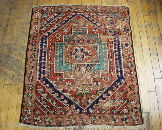 """Antique west Anatolian rug.  All natural colors. Good age, certainly 1st half 19th c. Rough with low pile, wear and damage. 4' x 4' 9"""""""