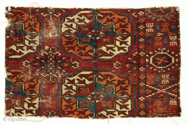 "Antique Tekke rug fragment. Not to big, not to small, just right. Makes a fine large mouse pad. All good colors. app. 12"" x 20"""