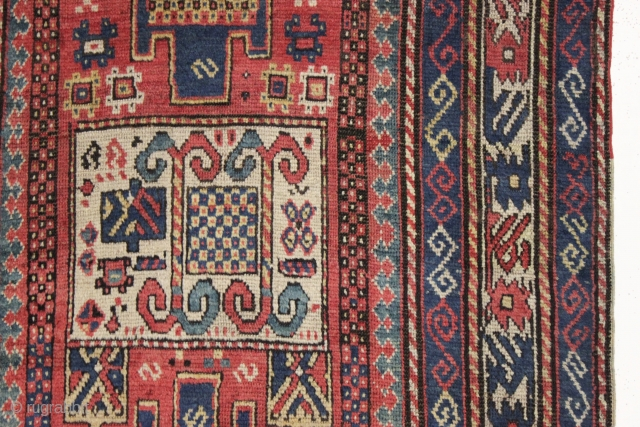 antique kazak in good condition with unusual soft coloring. Interesting example of a Kazak long rug with karachopf variant design. Nice active border. Mostly good fleecy pile. unusual soft palette with all  ...