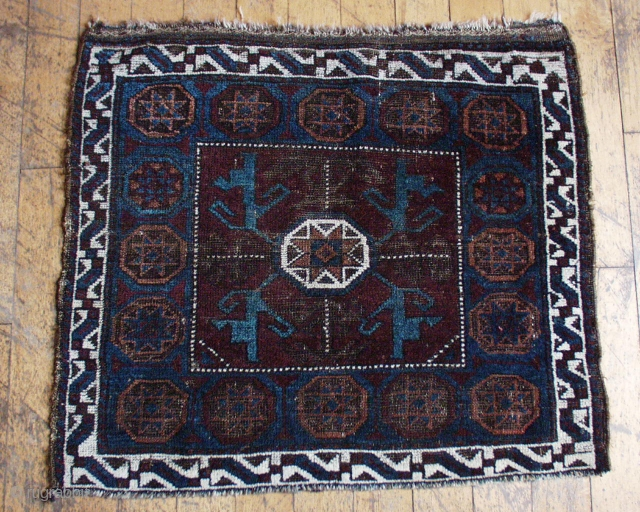 """Antique Baluch octagon bagface. Unusual coloring. Nice blues. Very low pile with wear and oxidized browns. All good colors. 19th c. 27"""" x 29"""""""