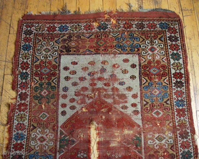 """Antique Turkish Melas prayer rug. Early example in rough condition. Spacious drawing and beautiful old colors. Thin and low and damaged. Transcendental. Not for the condition minded.  3' 5""""  x  ..."""