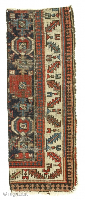 """Old rug fragment. Caucasian? Northwest Persian? Kurdish? All natural colors. Interesting design. Just the piece for that narrow wall space. 19th c. 16"""" x 44"""""""